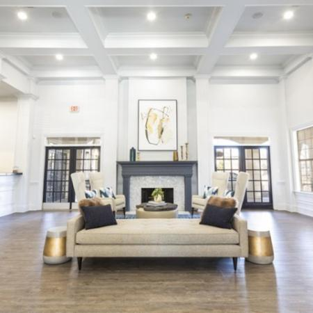 View of Renovated Clubhouse, Showing Tall Ceilings with Crown Molding, Seating Area, View into Community Kitchen at Stonebriar of Frisco Apartments