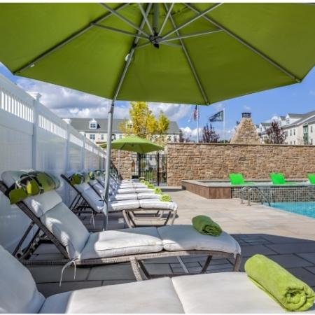 View of Pooldeck, Showing Loungers, Umbrellas, and Sunshelf at Cottonwood One Upland Apartments