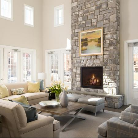 View of Clubhouse, Showing Seating Area, Brick Fireplace, And Wall of Windows at Cottonwood One Upland Apartments