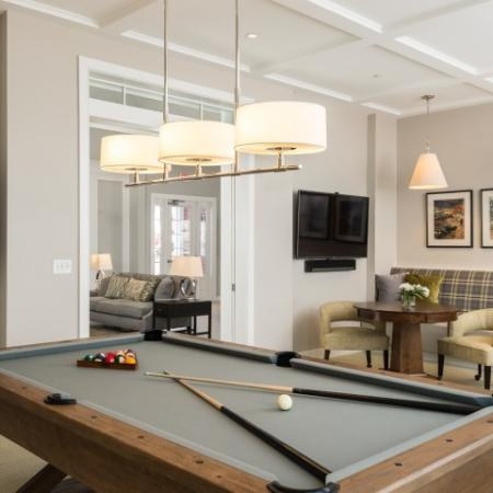 View of Clubhouse, Showing Billiards Room, Seating Area, and Flat Screen TV at Cottonwood One Upland Apartments