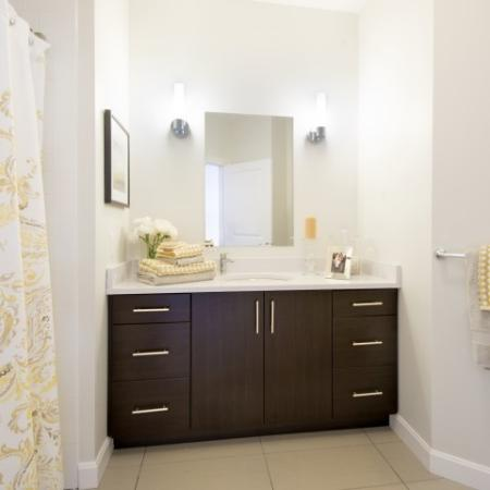 View of Bathroom, Showing Single Vanity With Storage, Mirror, Towel Bar, and Shower at Cottonwood One Upland Apartments