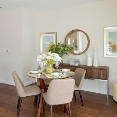 View of Furnished Dining Room, Showing Table and Chairs, Décor, and Plank Flooring at Cottonwood One Upland Apartments