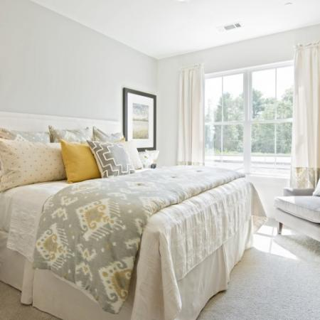 View of Furnished Bedroom, Showing Queen Size Bed, Décor, and Large Window at Cottonwood One Upland Apartments