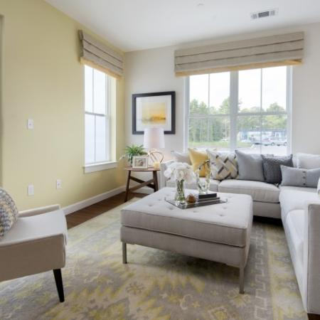 View of Furnished Living Room, Showing Sectional Sofa, Chair, Décor, and Large Window at Cottonwood One Upland Apartments