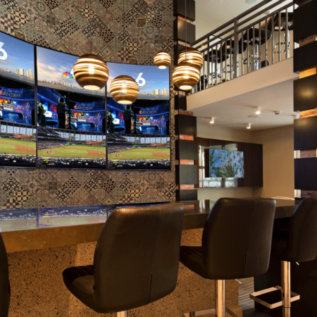 Sports Lounge with Flat Screen Televisions and Bar-Style Seating