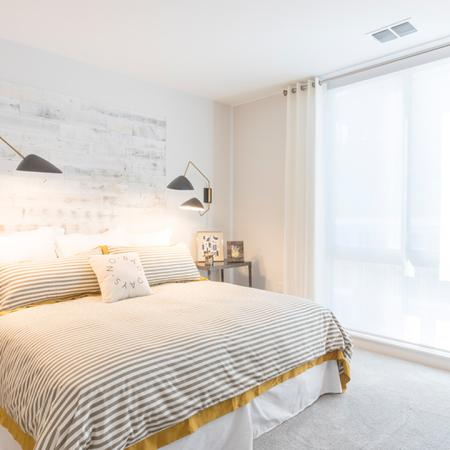 King-Sized Bedroom with Large Windows | Modera Midtown