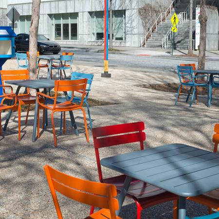 Local Establishment Outdoor Area with Brightly Colored Chairs