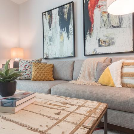 Lighted Living Space with Sofa and Coffee Table in One-Bedroom Model | Modera Midtown