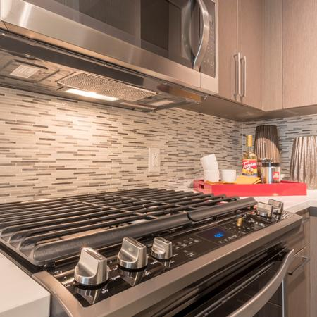 Tile Backsplash, Gas Cooktop and USB Ports in Kitchen