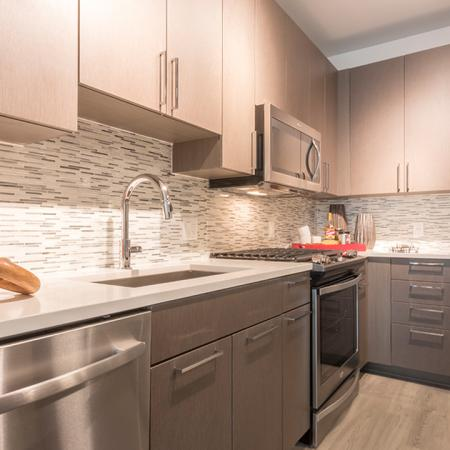Custom Light Grain 42-Inch Wood Cabinetry in Kitchens | Modera Midtown