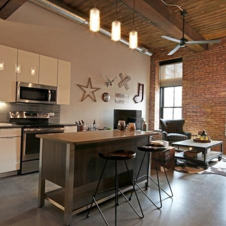 Polished Concrete Floors Throughout and Original Brick and Wood Beams Accent Apartments | Studio Lofts | Jersey City NJ Apartment Homes | Modera Lofts