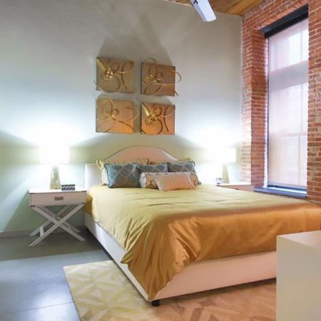 Exposed Brick from the Original Building Enhances the Bedroom  | Studios | Jersey City NJ Apartment Homes | Modera Lofts