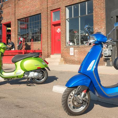 Exterior of local establishment with brightly colored Vespa's outside