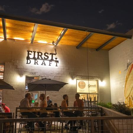 Exterior of local establishment First Draft at night