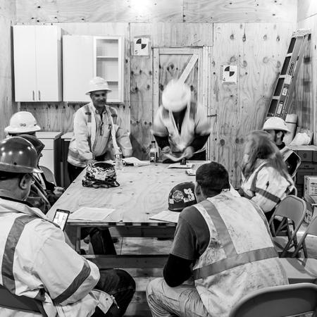 Black and white of construction team meeting