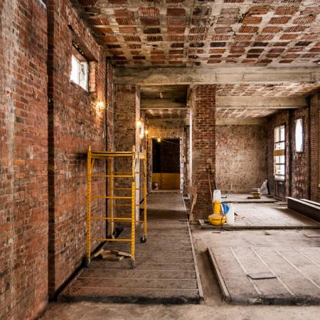 Galley room with exposed brick during renovations