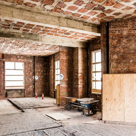 Interior room with exposed brick during renovation