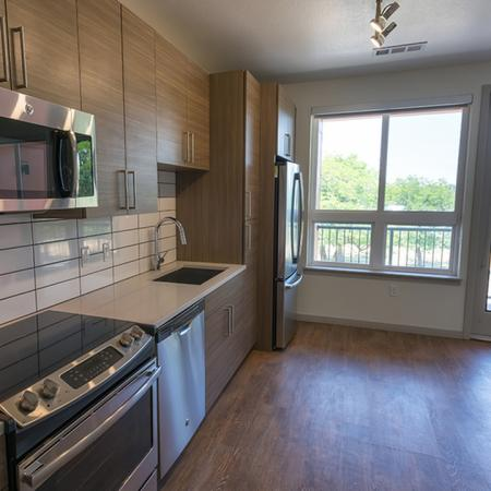 Studio Apartment with Wood Plank-Style Flooring and Private Balcony | Modera Observatory Park