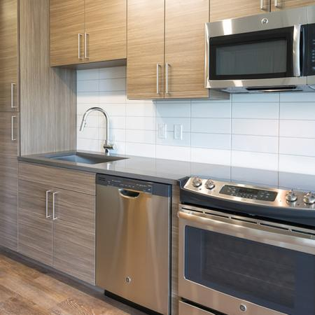 Stainless Steel and Custom Cabinets in our Studio Apartment Homes | Modera Observatory Park