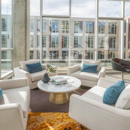 Enjoy the sun inside with floor to ceiling windows in the resident lounge