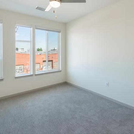 Open living room with over sized windows