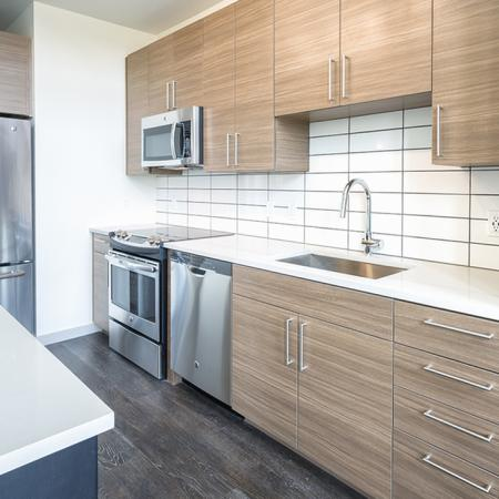 Stainless Steel and Custom Cabinets in our Studio Apartment Homes