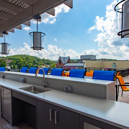 Rooftop mini bar with ample seating for entertaining