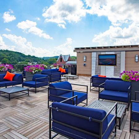 Rooftop seating options with ample seating, small tables with television