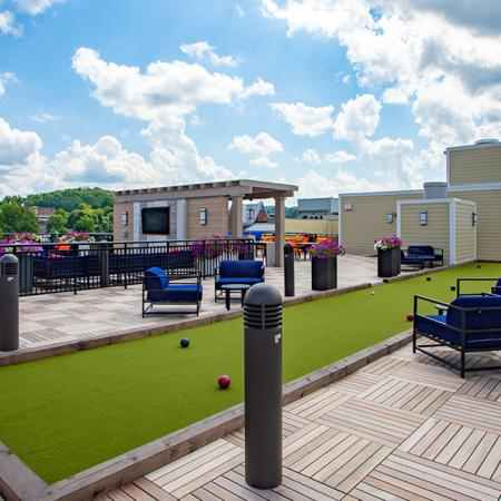Bocce ball on the rooftop surrounded by comfortable outdoor seating options