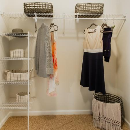 Walk in closet featuring dressing touches
