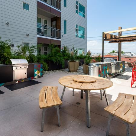 Exterior table and chairs near grilling stations