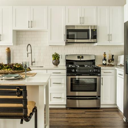 Naturally sophisticated kitchen area with island.