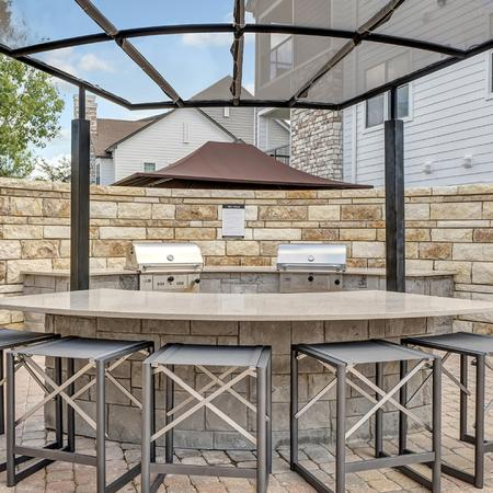 Outdoor Kitchen and Seating | Alister Balcones | Austin, Texas | Apartment Homes | Cozy Living Spaces