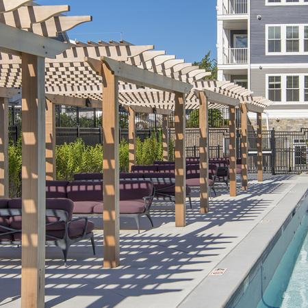 Partially Shaded Sun Deck and Salt Water Pool  | Modera Needham | Apartment Homes | Needham, MA Apartments