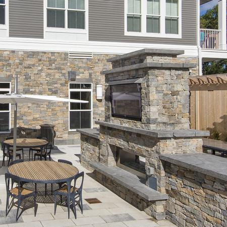 Outdoor Deck, Private Dining and BBQ Area  | Modera Needham | Apartment Homes | Needham, MA Apartments