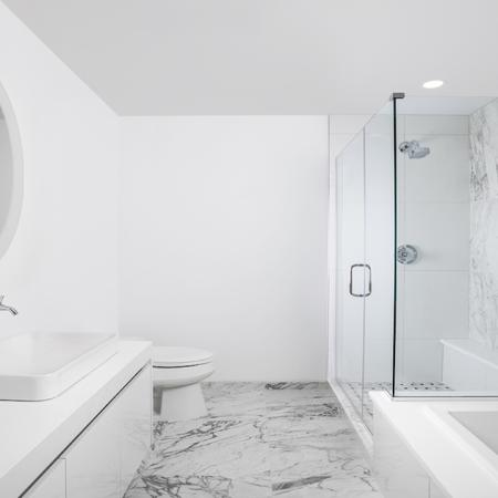 Spa Inspired Bathrooms featuring floor to ceiling marble for bath and shower