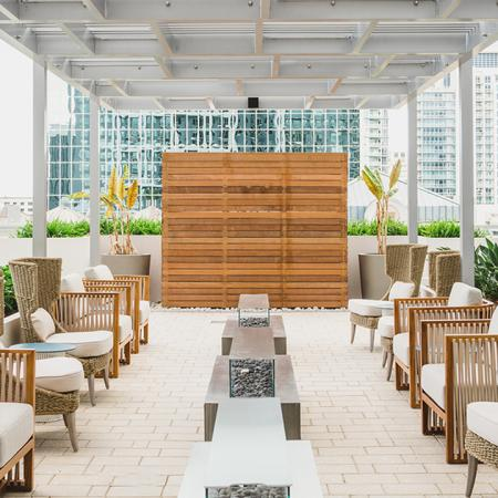 Outdoor, rooftop seating options with line of fire pits