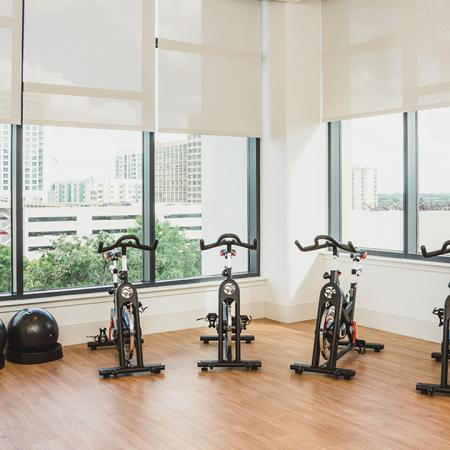 Indoor fitness area featuring spin bikes