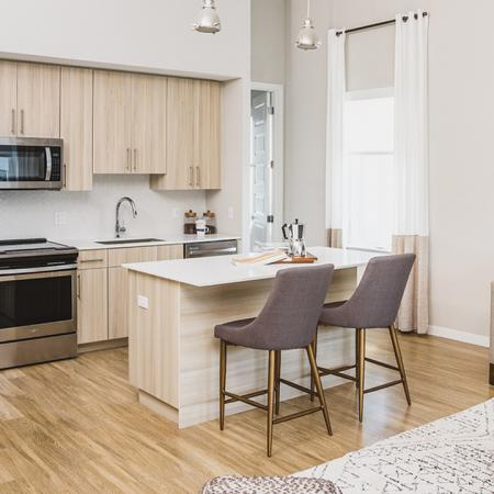 Open Kitchens with Wood Plank Flooring | Apartment Homes in Orlando, Florida | Luxury Apartments in Orlando