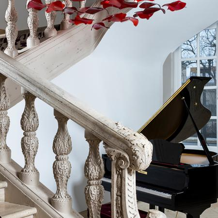 Grand Piano in Foyer with Large Window in Background