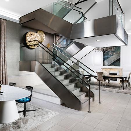 A touch of modern with a steel and glass staircase amidst the leasing area