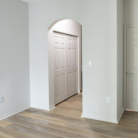 Bedroom with archway leading to closet