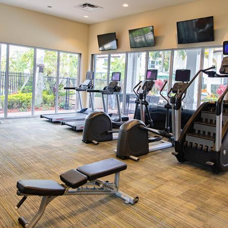 Fitness center with treadmills, elliptical machine, and stair climber