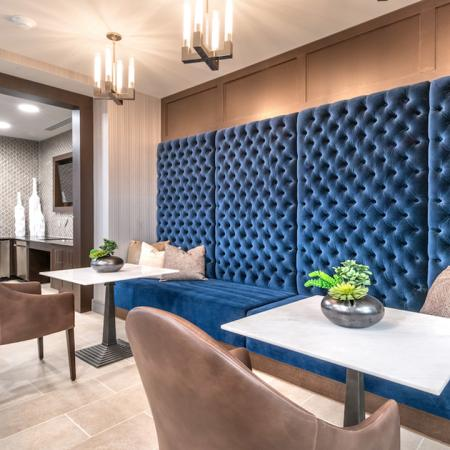 Resident Lounge with Blue Velvet Wall Seating with Table and Chair