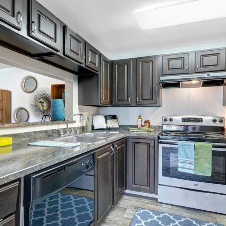 Redesigned Kitchen featuring granite counter-tops and stainless steel appliances