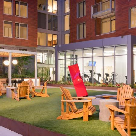 Outdoor courtyard with turf grass and various seating options