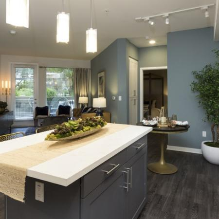 Kitchen with large island and high ceilings.