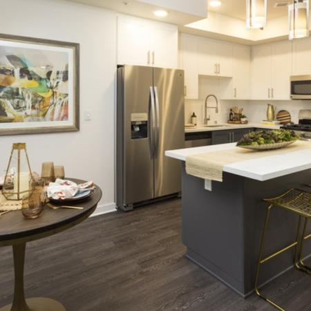 Kitchen with island and dining area.