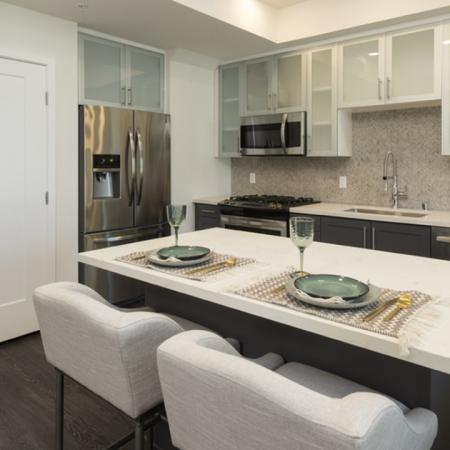 Kitchen with stainless steel appliances and large island.