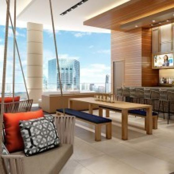 Rooftop resident lounge with outdoor bar and unique hanging seating